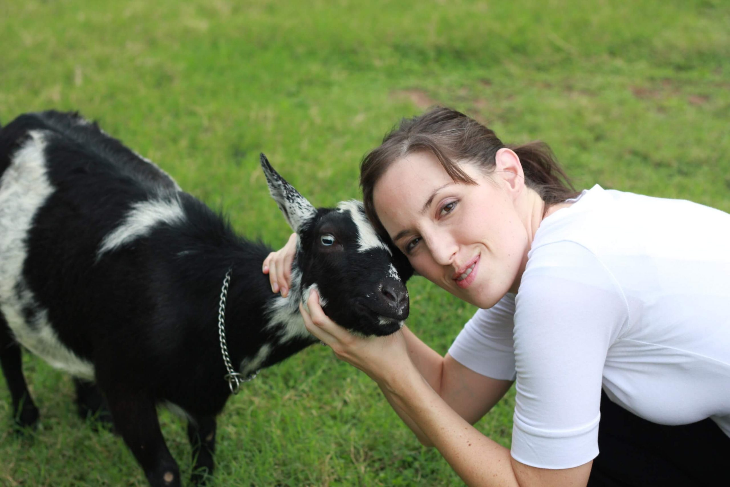 woman with black goat